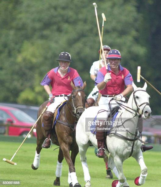 Prince Harry plays polo with his father the Prince of Wales for Highgrove in an exhibition match against Cirencester Park in aid of Plymouth's St...