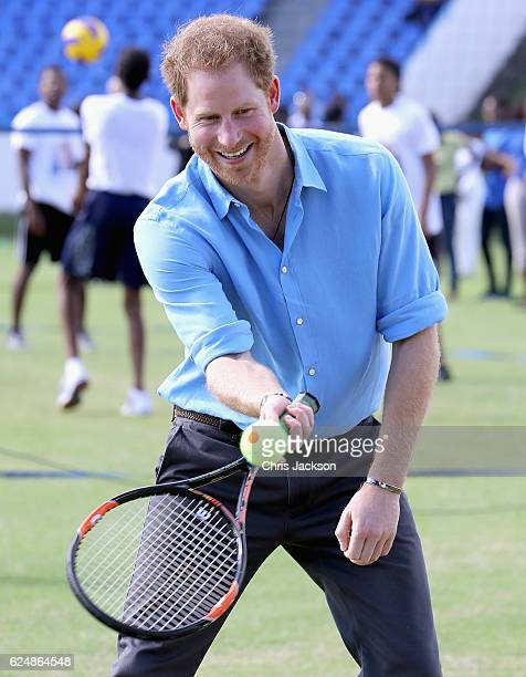 Prince Harry plays tennis as he attends a youth sports festival at Sir Vivian Richards Stadium showcasing Antigua and Barbuda's national sports on...