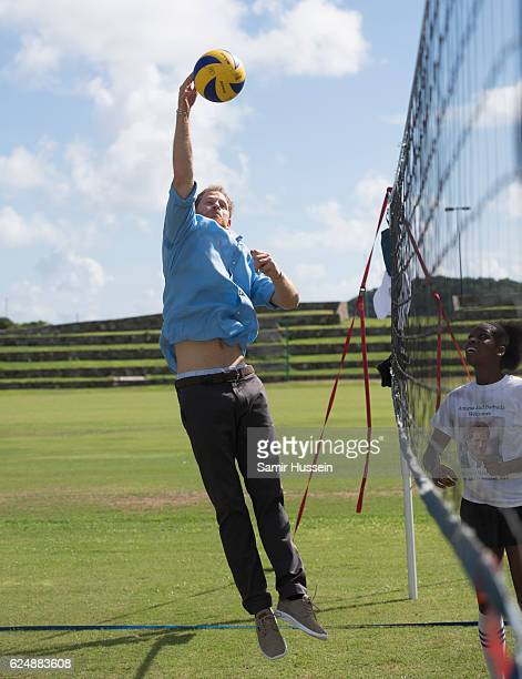 Prince Harry plays volleyball at a Youth Sports Festival at the Sir Vivian Richards Stadium on the second day of an official visit on November 21...