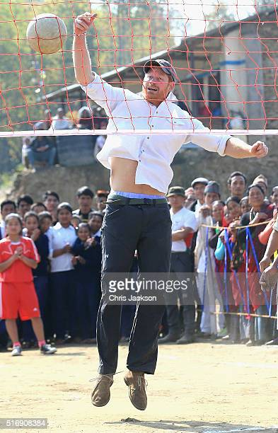 Prince Harry plays volleyball in the Himalayan village of Okhari on day four of his visit to Nepal on March 22 2016 in Okhari Nepal Prince Harry is...
