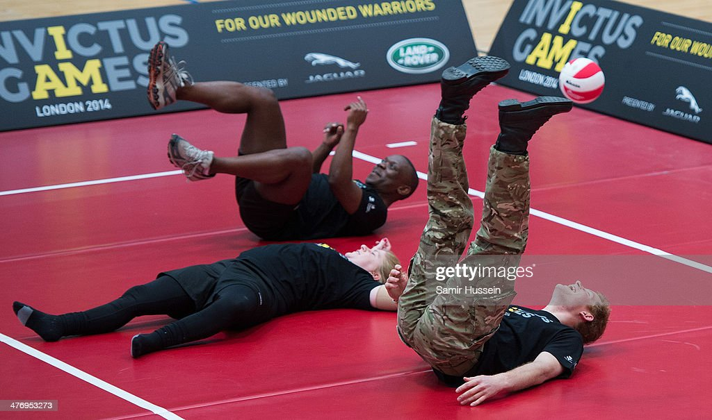<a gi-track='captionPersonalityLinkClicked' href=/galleries/search?phrase=Prince+Harry&family=editorial&specificpeople=178173 ng-click='$event.stopPropagation()'>Prince Harry</a> plays volleyball with wounded Service personnel as at the launch of the Invictus Games For Our Wounded Warriors on March 6, 2014 in London, England.