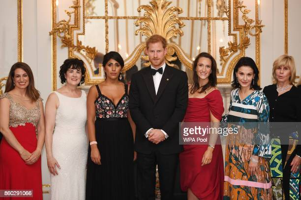 Prince Harry poses for a photo with Amanda Pullinger Chief Executive Officer of 100 Women in Finance and Sonia Gardner as he attends 100 Women in...