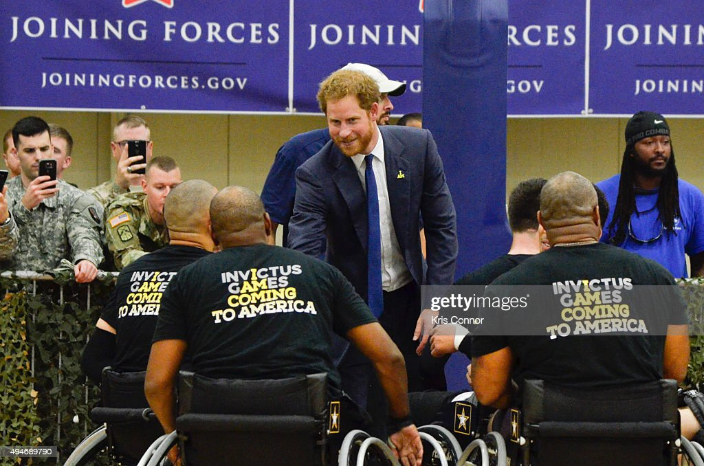 Prince Harry poses for a photo with players during the Joining Forces Invictus Games 2016 Event at the Wells Fields House on October 28, 2015 in Fort Belvoir, Va.