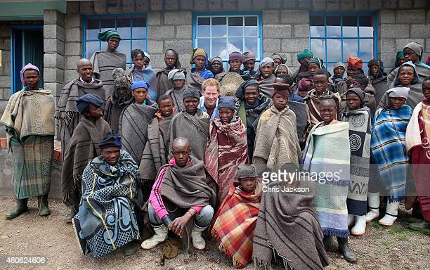 Prince Harry poses for a photograph with herd boys during a visit to a herd boy night school constructed by Sentebale on December 8 2014 in...