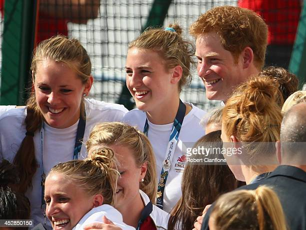 Prince Harry poses for a photograph with the England women's hockey team at Glasgow National Hockey Centre during day five of the Glasgow 2014...