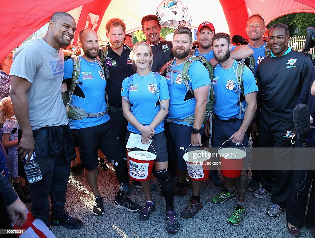 Prince Harry (3rdL) poses for a team photo outside Ludlow Castle with the Walking with the Wounded's Walk of Britain team on September 30, 2015 in Ludlow, England. Prince Harry is patron of the expedition and walked today as part of the veteran's 1000 mile, 72 day expedition through the UK mainland.