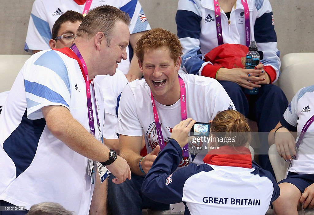 <a gi-track='captionPersonalityLinkClicked' href=/galleries/search?phrase=Prince+Harry&family=editorial&specificpeople=178173 ng-click='$event.stopPropagation()'>Prince Harry</a> poses for photos with British Paralympic athletes on day 6 of the London 2012 Paralympic Games at the Aquatics Centre on September 4, 2012 in London, England.