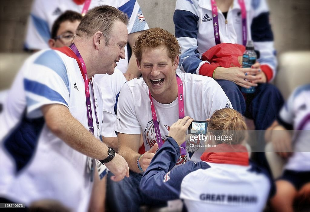 Prince Harry poses for photos with British Paralympic athletes on day 6 of the London 2012 Paralympic Games at the Aquatics Centre on September 4, 2012 in London, England.