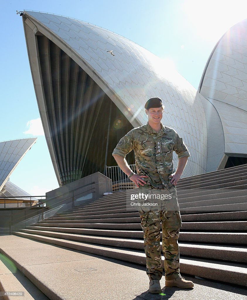 Prince Harry poses outside the Sydney Opera House on May 7, 2015 in Sydney, Australia. Prince Harry is visiting Sydney following a month-long deployment with the Australian Army.