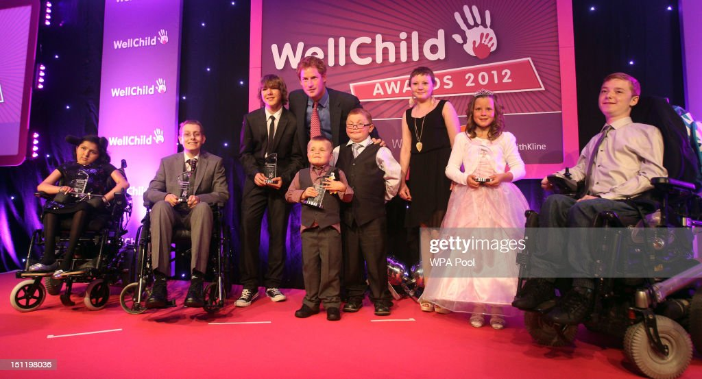 Prince Harry poses with all award winners at the WellChild Awards at the Intercontinental Hotel on September 3, 2012 in London, England.
