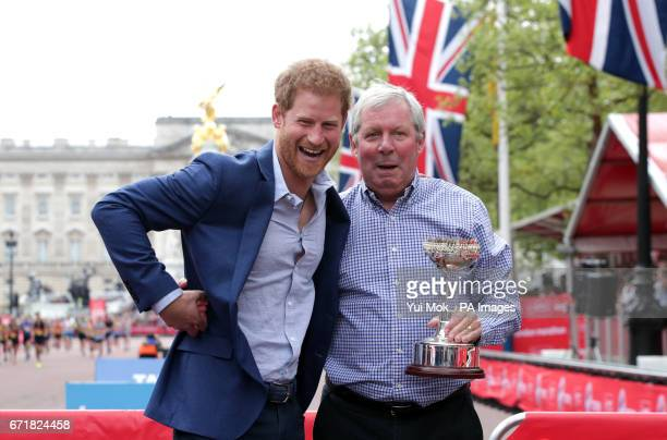 Prince Harry poses with Brendan Foster during the Virgin Money London Marathon London PRESS ASSOCIATION Picture date Sunday April 23 2017 See PA...