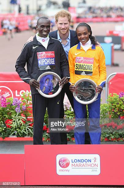 Prince Harry poses with Elite Mens winner Eluid Kipchoge of Kenya and Elite womens winner Jemima Sumgong of Kenya after the Virgin Money Giving...