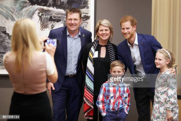 Prince Harry poses with friends and family as he attends the True Patriot Love Symposium at Scotia Plaza during a pre Invictus Games event on...