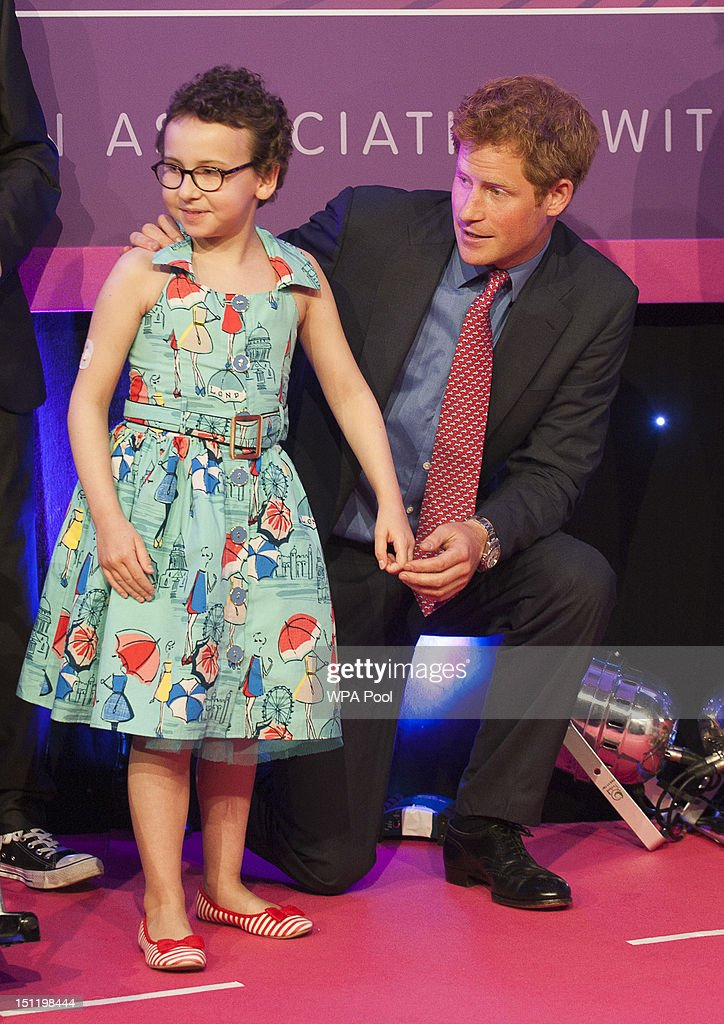 <a gi-track='captionPersonalityLinkClicked' href=/galleries/search?phrase=Prince+Harry&family=editorial&specificpeople=178173 ng-click='$event.stopPropagation()'>Prince Harry</a> poses with inspirational child winner Rose Whittle at the WellChild Awards at the Intercontinental Hotel on September 3, 2012 in London, England.