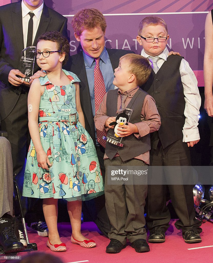 <a gi-track='captionPersonalityLinkClicked' href=/galleries/search?phrase=Prince+Harry&family=editorial&specificpeople=178173 ng-click='$event.stopPropagation()'>Prince Harry</a> poses with inspirational child winners (L-R) Rose Whittle, Alex Logan and Matthew Merritt at the WellChild Awards at the Intercontinental Hotel on September 3, 2012 in London, England.
