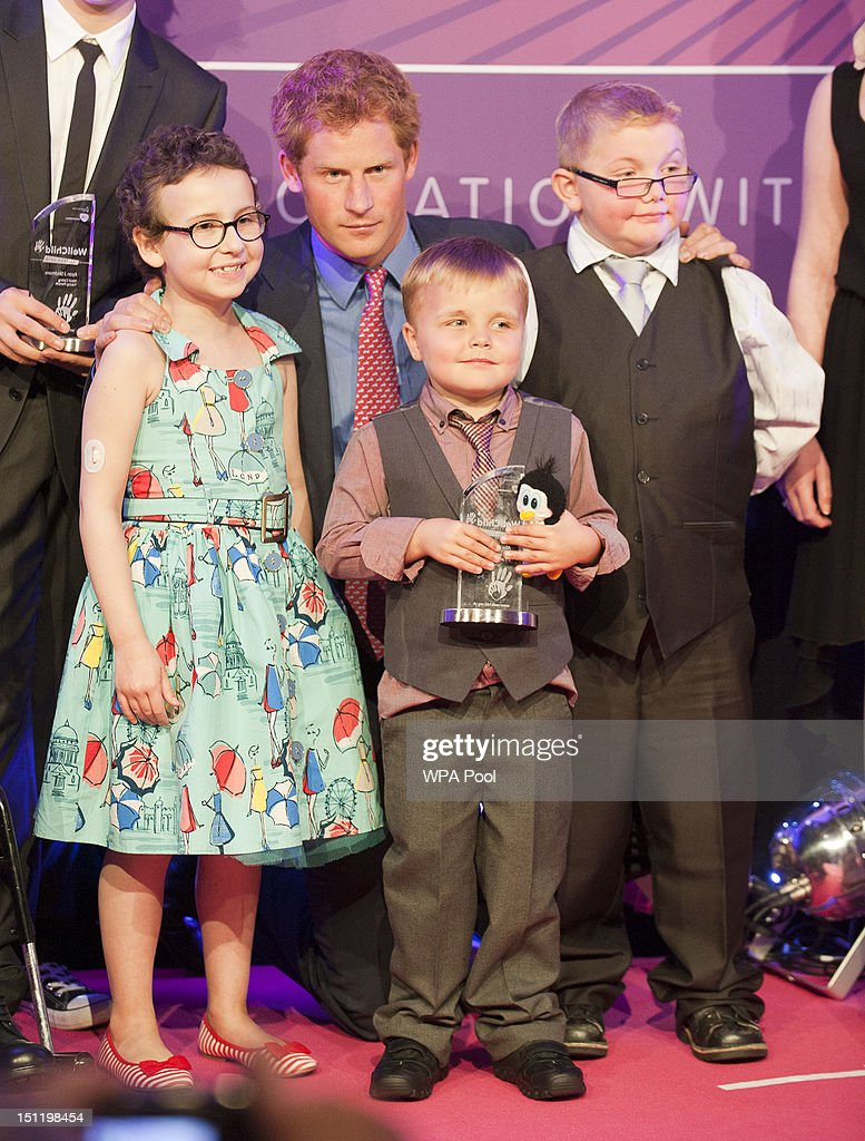Prince Harry poses with inspirational child winners (L-R) Rose Whittle, Alex Logan and Matthew Merritt at the WellChild Awards at the Intercontinental Hotel on September 3, 2012 in London, England.