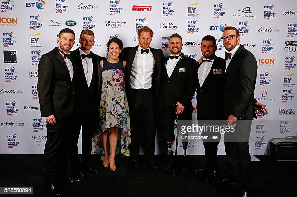 Prince Harry poses with Invictus team members at the BT Sport Industry Awards 2016 at Battersea Evolution on April 28 2016 in London England The BT...