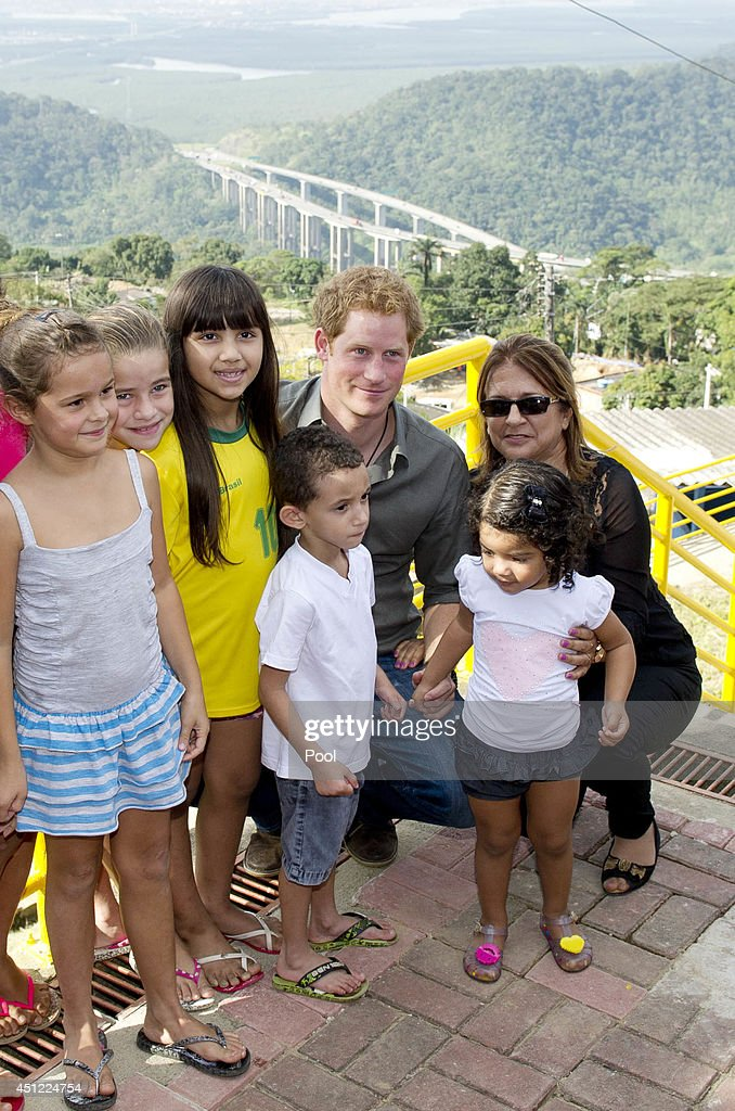 <a gi-track='captionPersonalityLinkClicked' href=/galleries/search?phrase=Prince+Harry&family=editorial&specificpeople=178173 ng-click='$event.stopPropagation()'>Prince Harry</a> poses with local children from a village during a trip to the Atlantic Rainforest on June 25, 2014 near Sao Paulo, Brazil. <a gi-track='captionPersonalityLinkClicked' href=/galleries/search?phrase=Prince+Harry&family=editorial&specificpeople=178173 ng-click='$event.stopPropagation()'>Prince Harry</a> is on a four day tour of Brazil that will be followed by two days in Chile.