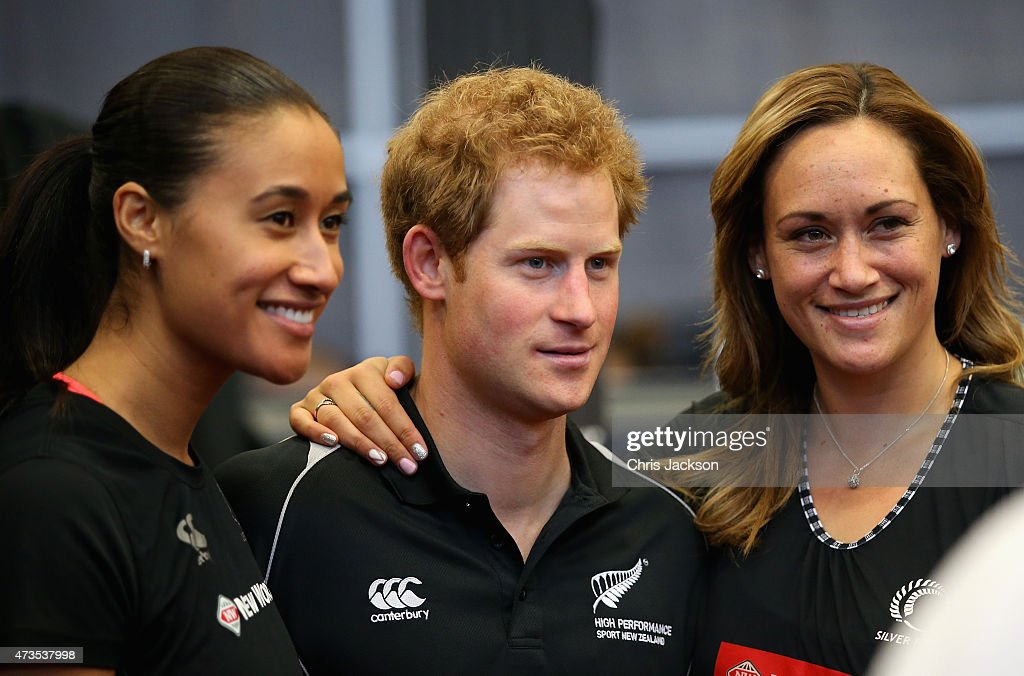 Prince Harry poses with Silver Ferns Maria Tutaia and Catherine Latu at the AUT Millenium Institute on May 16 2015 in Auckland New Zealand Prince...