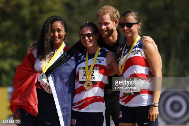 Prince Harry poses with Silver Medal winner Sabrina Daulaus of Team France Gold Medal winner Sarah Rudder of Team USA and Bronze Medal winner Christy...
