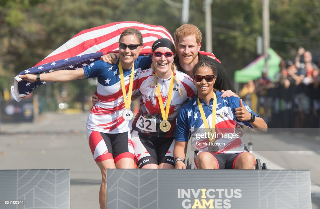Prince Harry poses with the medal winning competitors at the Cycling Time Trial on day 4 of the Invictus Games Toronto 2017 on September 26, 2017 in Toronto, Canada. The Games use the power of sport to inspire recovery, support rehabilitation and generate a wider understanding and respect for the Armed Forces.