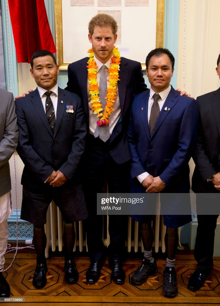 Prince Harry poses with two Gurkhas who he served with in Afghanistan (L-R) Rifleman Vinod Budhathoki, 32, and Corporal Hair Budha Magar, 37, as he attends a ceremony to celebrate the bicentenary of relations between the UK and Nepal at Embassy of Nepal on March 20, 2017 in London, England. Both Gurkhas were badly injured in Afghanistan both losing their legs.
