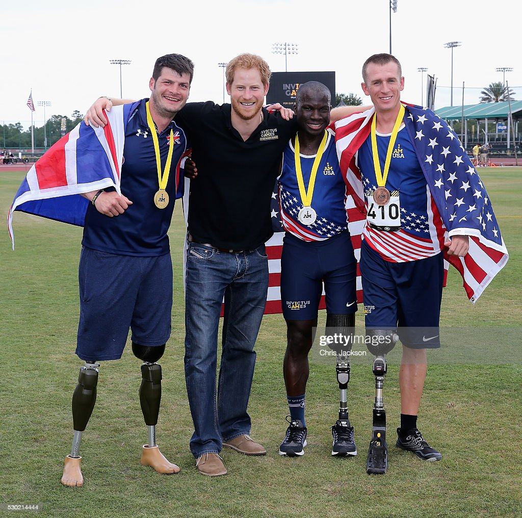 Prince Harry poses with UK Armed Forces Athlete Dave Henson (with Gold in the 200m) and other medal winners at the track and field events during the Invictus Games Orlando 2016 at ESPN Wide World of Sports on May 10, 2016 in Orlando, Florida. Prince Harry, patron of the Invictus Games Foundation is in Orlando for the Invictus Games 2016. The Invictus Games is the only International sporting event for wounded, injured and sick servicemen and women. Started in 2014 by Prince Harry the Invictus Games uses the power of Sport to inspire recovery and support rehabilitation.