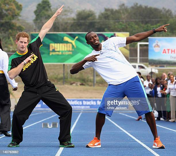Prince Harry poses with Usain Bolt at the Usain Bolt Track at the University of the West Indies on March 6 2012 in Kingston Jamaica Prince Harry is...