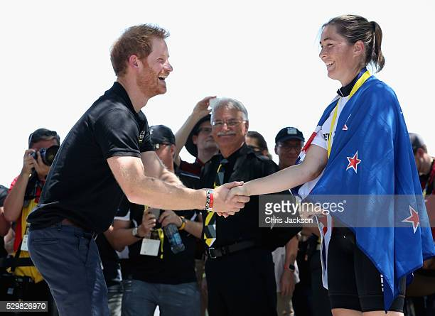 Prince Harry presents Amy Baynes with Silver in the Time Trial Cycling during the Invictus Games Orlando 2016 at ESPN Wide World of Sports on May 9...