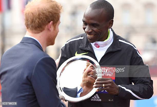 Prince Harry presents Eliud Kipchoge with his award after he won the Mens Virgin London Marathon 2016 on April 24 2016 in London England