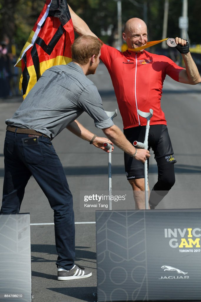 Prince Harry presents medals during the Cycling on day 5 of the Invictus Games Toronto 2017 in High Park on September 27, 2017 in Toronto, Canada. The Games use the power of sport to inspire recovery, support rehabilitation and generate a wider understanding and respect for the Armed Forces.