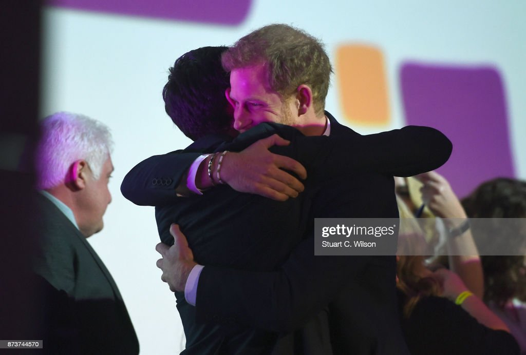 Prince Harry presents the award for Best Documentary to the Mind Over Marathon runners on stage at the Virgin Money Giving Mind Media Awards at Odeon Leicester Square on November 13, 2017 in London, England.