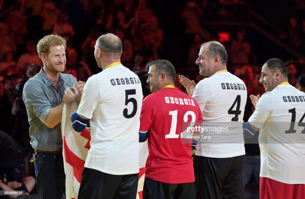 Prince Harry presents the gold medals to the Georgia Seated Volleyball team on day 5 of the Invictus Games Toronto 2017 at Mattamy Athletic Centre on September 27, 2017 in Toronto, Canada. The Games use the power of sport to inspire recovery, support rehabilitation and generate a wider understanding and respect for the Armed Forces.