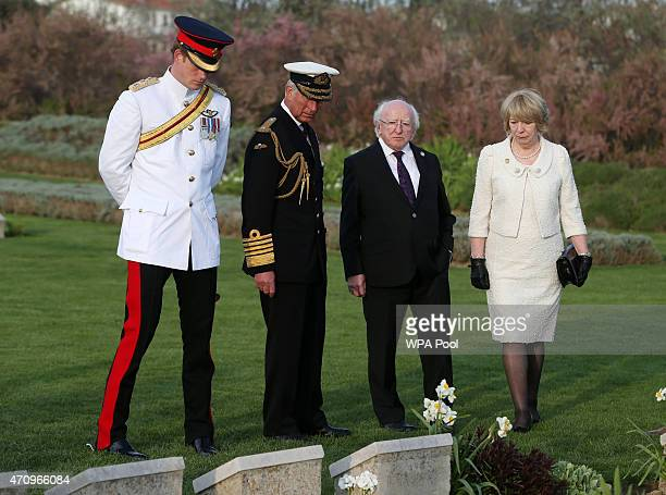 Prince Harry Prince Charles Prince of Wales and Irish President Michael D Higgins and his wife Sabina during a visit to V Beach cemetery close to the...