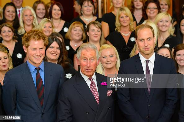Prince Harry Prince Charles Prince of Wales and the Prince William Duke of Cambridge pose for a photo with members of the Military Wives Choir at the...