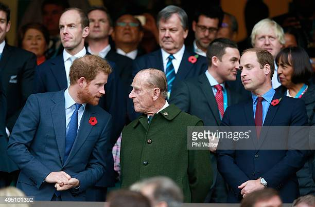 Prince Harry Prince Phillip and Prince William enjoy the atmosphere during the 2015 Rugby World Cup Final match between New Zealand and Australia at...