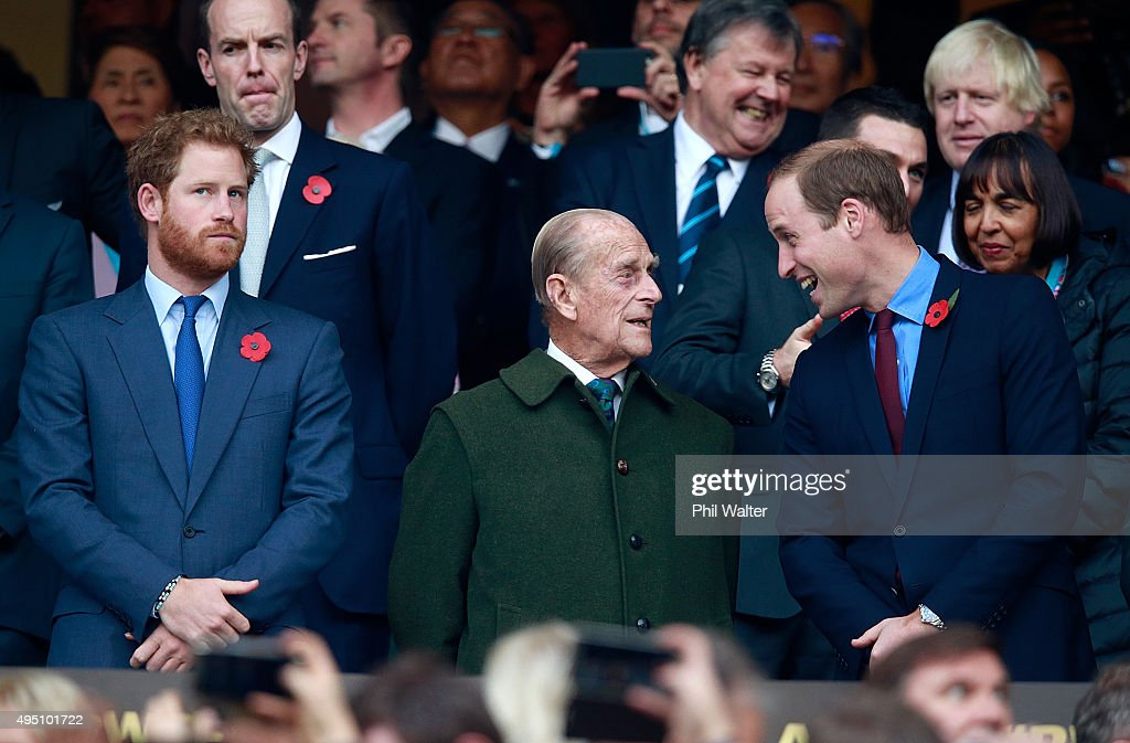 Prince Harry, Prince Phillip and Prince William enjoy the build up to the 2015 Rugby World Cup Final match between New Zealand and Australia at Twickenham Stadium on October 31, 2015 in London, United Kingdom.