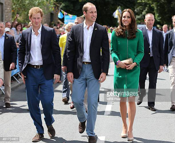 Prince Harry Prince William Duke of Cambridge and Catherine Duchess of Cambridge walk along the street to celebrate the start of the Tour de France...