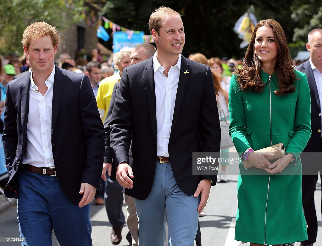 Prince Harry, Prince William, Duke of Cambridge and Catherine, Duchess of Cambridge walk along the street to celebrate the start of the Tour de France on July 5, 2014 at West Tanfield, Yorkshire, England.