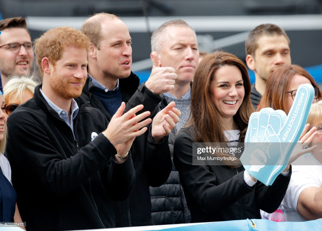 Prince Harry, Prince William, Duke of Cambridge and Catherine, Duchess of Cambridge (wearing a giant foam hand) cheer on runners talking part in the 2017 Virgin Money London Marathon on April 23, 2017 in London, England. The Heads Together mental heath campaign, spearheaded by The Duke & Duchess of Cambridge and Prince Harry, is the marathon's 2017 Charity of the Year.