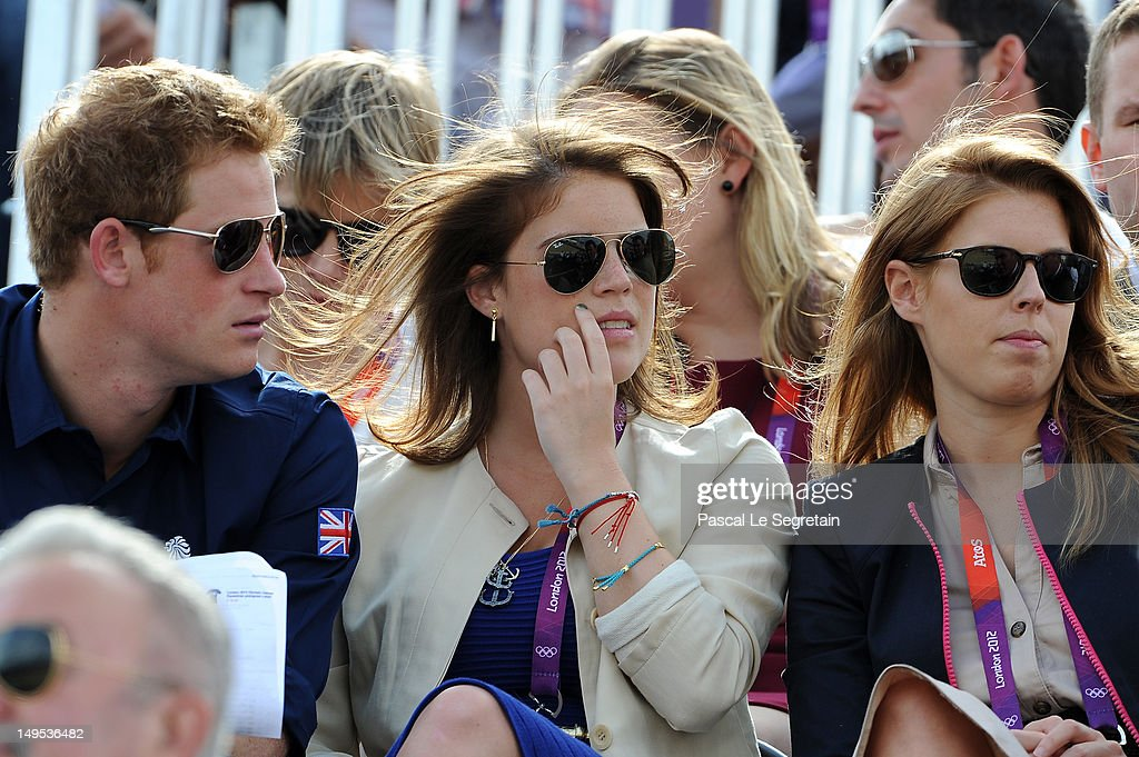 Prince Harry, Princess Eugenie, and Princess Beatrice watch the Eventing Cross Country Equestrian event on Day 3 of the London 2012 Olympic Games at Greenwich Park on July 30, 2012 in London, England.