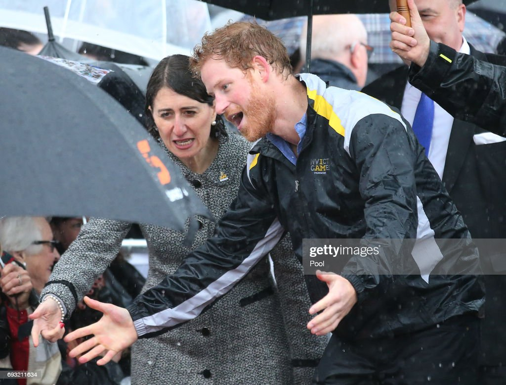 Prince Harry reacts as he recognises 97-year-old Daphne Dunne, who he had met on an earlier visit to Sydney, during an event where he met members of the public in the pouring rain at The Rocks on June 7, 2017 in Sydney, Australia. Prince Harry is on a two-day visit to Sydney for the launch of the Invictus Games Sydney 2018. The fourth Invictus Games will be held in Sydney from 20th to 27th October, 2018 and will include over 500 competitors from 17 nations competing in 10 adaptive sports events.