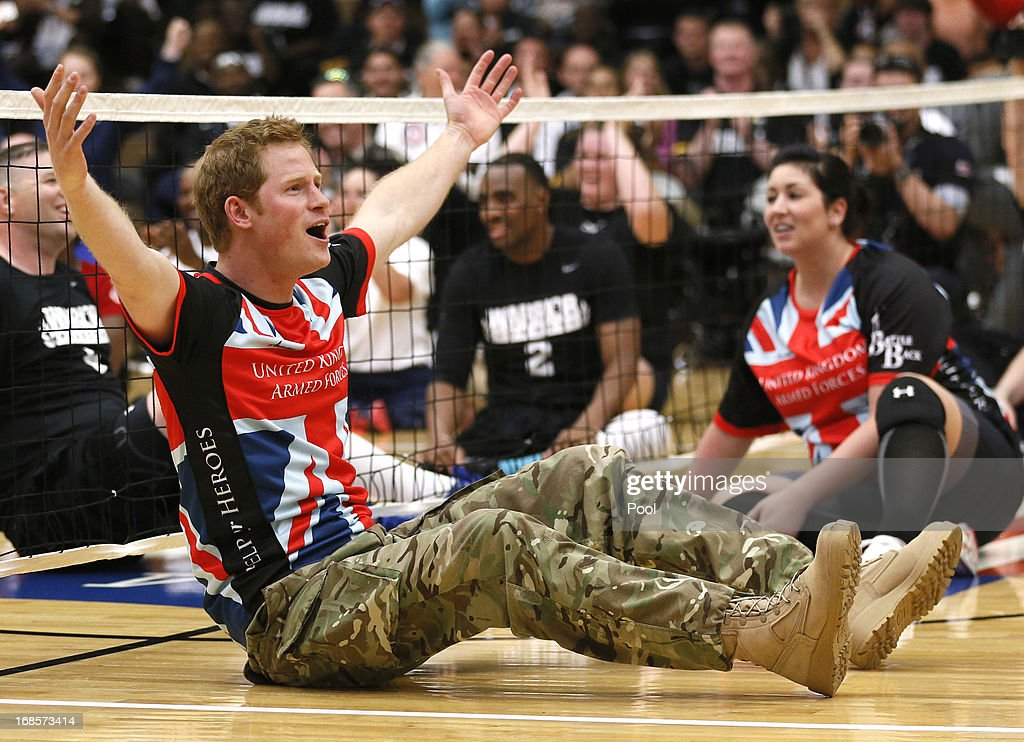 HRH Prince Harry reacts while playing sitting volleyball with the UK team at a visit to the Warrior Games Opening at the U.S. Olympic Training Center on May 11, 2013 in Colorado Springs, Colorado. HRH will be undertaking engagements on behalf of charities with which the Prince is closely associated on behalf also of HM Government, with a central theme of supporting injured service personnel from the UK and US forces.