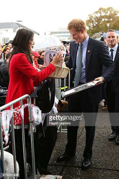 Prince Harry receives a gift from a fan during a public walkabout at Wanganui War Memorial Centre on May 14 2015 in Wanganui New Zealand Prince Harry...