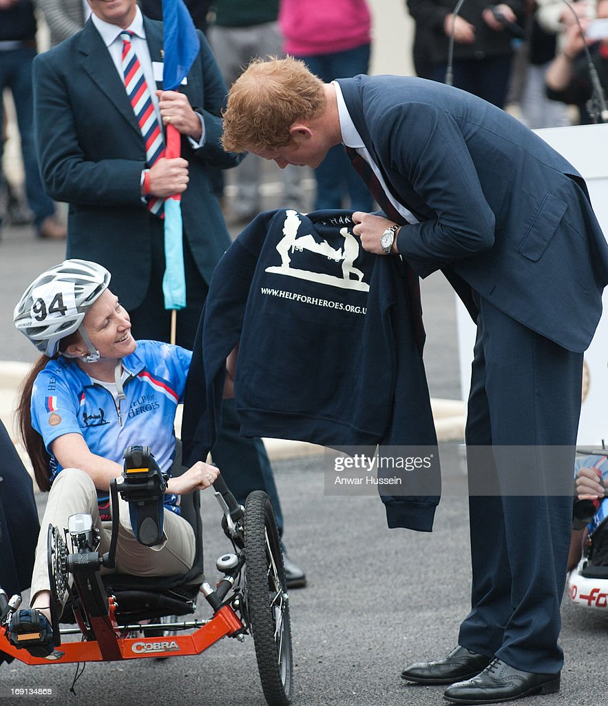Prince Harry receives a 'Help For Heroes' sweatshirt with his name as he visits Help For Heroes Recovery Centre on May 20, 2013 in Tidworth, England.