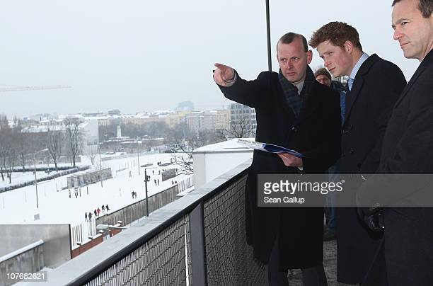 Prince Harry receives a history instruction by Axel Klausmeier Director of the Berlin Wall Foundation during a visit to the observation platform of...