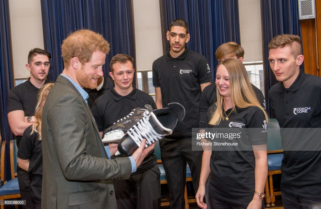 prince-harry-receives-a-pair-of-ice-skates-signed-by-the-graduats-of-picture-id633288000