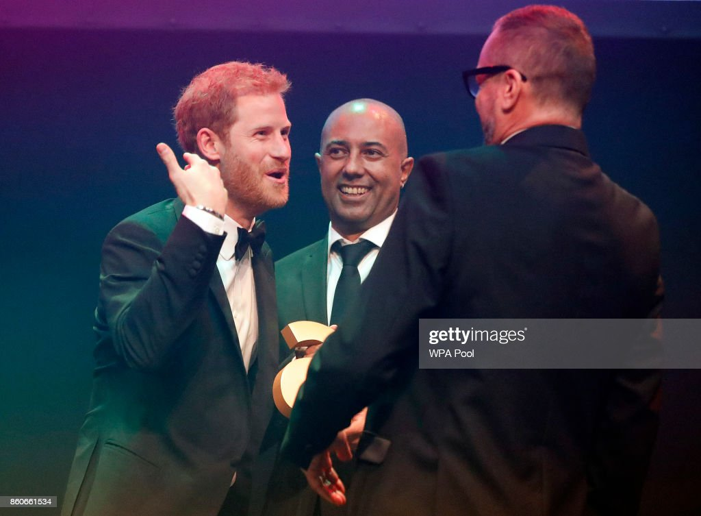 Prince Harry receives a posthumous Attitude Legacy Award on behalf of his mother Diana, Princess of Wales, from Ian Walker, right, and Julian La Bastide at the Attitude Awards on October 12, 2017 in London, England. Attitude Magazine is awarding the prize to the late Princess Diana in honour of her significant work in drawing attention to HIV