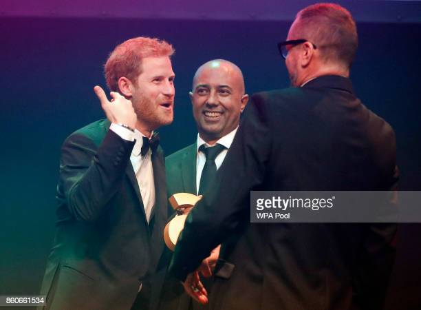 Prince Harry receives a posthumous Attitude Legacy Award on behalf of his mother Diana Princess of Wales from Ian Walker right and Julian La Bastide...