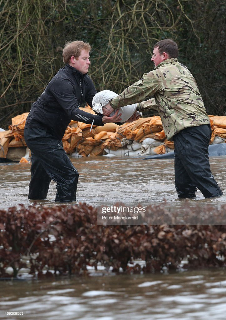 <a gi-track='captionPersonalityLinkClicked' href=/galleries/search?phrase=Prince+Harry&family=editorial&specificpeople=178173 ng-click='$event.stopPropagation()'>Prince Harry</a> receives a sandbag from a soldier as they build a flood defence wall at Eton End School on February 14, 2014 in Datchet, England. Flood water has remained high in some areas and high winds are causing disruption to other parts of the UK with the Met Office issuing a red weather warning.